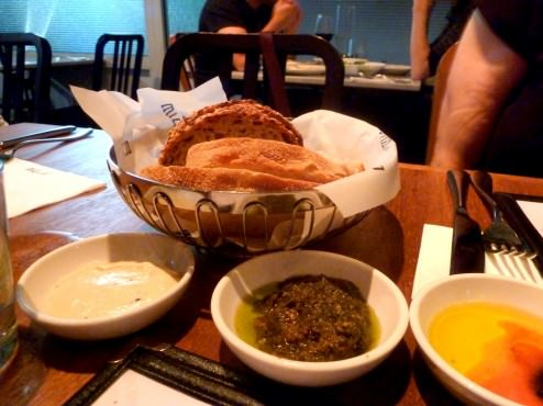 Bread basket (14 NIS), we received two types of fresh bread, white and dark, only 2-3 slices of each with three condiments: olive oil-tomato-balsamic vinegar; za'atar pesto, eggplant cream. All three were excellent. The eggplant cream was smokey but smooth, the pesto very cool as well.