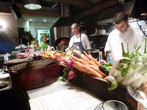 Most of the kitchen is out in the middle of the restaurant, with a big brick oven and all the mise-en-place ready in the middle of the bar.