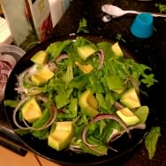 A bed of avocado, rocket, yogurt and onions