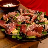 Sashimi salad: yogurt, rocket, red onions, avocado, black olives and sesame with fresh bonito.