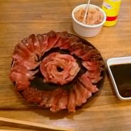 Another way to eat shashimi is cut nicely in the shape of a flower with soy-vinegar.