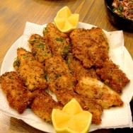 Calamari steaks Milanese (Shnitzel) with home made bread crumbs, garlic and basil. Don't forget to press lemon juice on top.