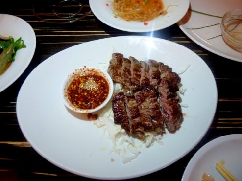 "Sliced Roasted Beef ""NEUA YANG"" , Roughly sliced Roasted Beef served with traditional hot sauce (46 NIS). Excellent way to eat a steak. The sauce was a great match, the meat tender and red in the center. Simple but successful dish."