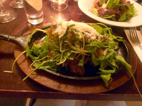 Rokach steak - seared veal chunks served on a hot iron pan, arugula, balsamic vinaigrette and parmesan. The disappointment of the meal came as thin slices of meat - too thin and covered with a blanket of greens. Serving on a sizzling pan over-cooked the meat.
