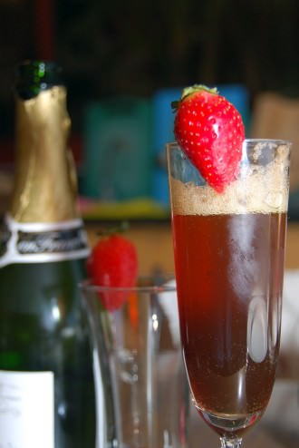 Sparkling wine cocktail with cherry heering liqueur and strawberry