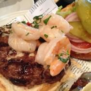 Shrimp burger (65 NIS). Isn't a burger made from shrimp only (bummer), but a burger with a small dish of shrimp tossed in white wine, garlic and a touch of cream on top. The sauce is really good and adds a lot to the flavor but leaks from the burger.