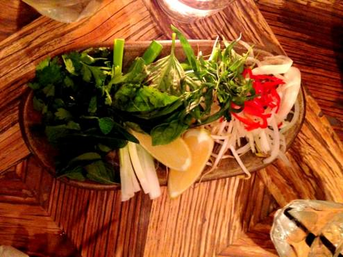 The plate of herbs: Cilantro, bean sprouts, chili, lemon, basil and mint. Very nice and colorful.