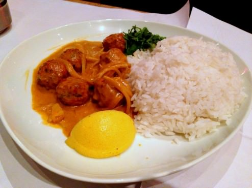 Chicken and ginger meatballs with coconut curry sauce and pineapple.