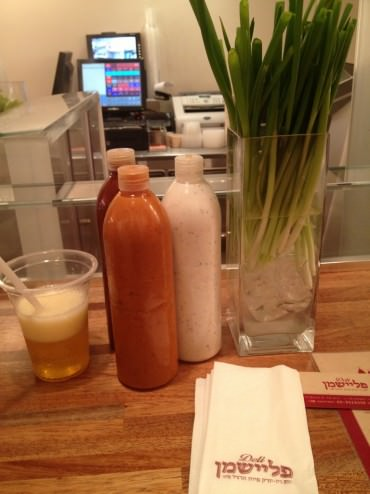 Spring onions in a vase and free refill sodas in Fleishman Deli