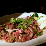 Naam-Tuk: Spicy raw beef salad with green onions, cilantro, lemon grass, shallots, mint, chili, roasted rice and lemon (43 NIS).