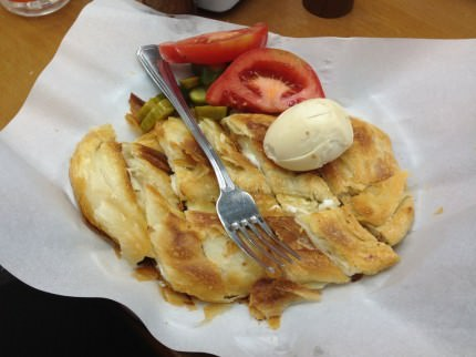 "The ""Complete Burekas Dish"" (25 ILS) served with thick slices of ripe delicious tomatoes, great home-made pickles and a boiled egg - Original Turkish Burekas"