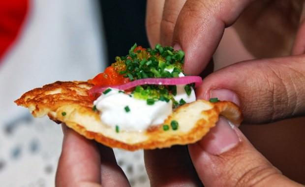 White cheese blinis, salmon roe, tobico, sour cream, chives, pickled onion