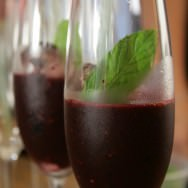 Refreshing cocktail of red fruits, vodka, orange juice and mint
