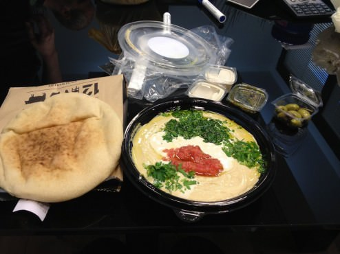 """The """"Brother's Hummus"""" with red salsa, Tahini and two pitas (22 ILS)."""