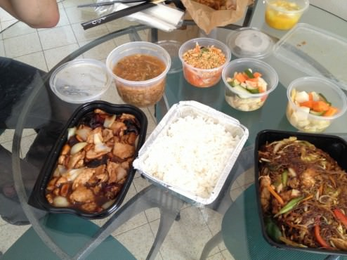 Chinese pickles, salad, spicy sour soup, pork dish and noodles dish