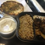 3 lamb kebabs sitting on top of warm tahini with pine nuts and grilled onions, a side dish of Majadra and some good portion of great hummus (37 ILS) came with pita and Za'atar pita.