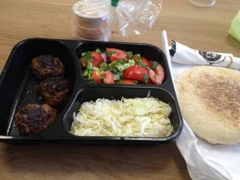 3 Lamb and beef meat balls, with two fresh salads, tomatoes and cabbage (30 ILS). Came with two little spicy sauces - one spicy eggplant and one pickled lemons and a Pita bread.