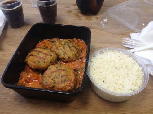 Grouper fish balls with tomatoes, garlic, butter and white wine sauce and white rice (53 ILS).