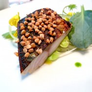 Miso marinated Mackerel with buckwheat crust over a salad of leeks, celery, oyster leaves and edible flowers