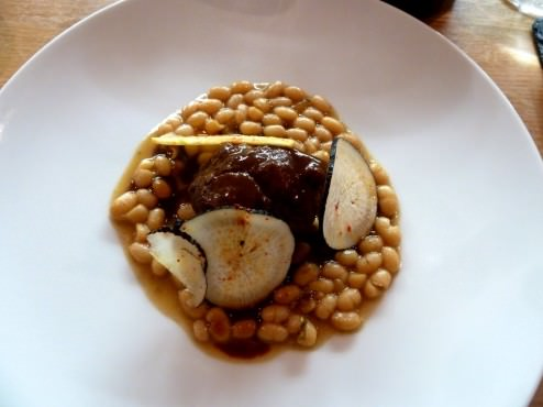 Braised pork cheek, cooked beans and black radish with red wine and miso sauce.