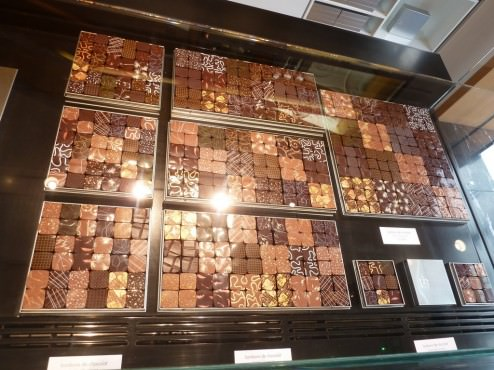 dozens of different chocolate pralines, sparkling back at you from the reflection of the high ceiling lights like jewelry.