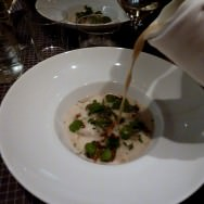 Pouring the broth over the morels and escargot