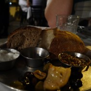"""Bread: Two types of Sourdough with Olives, Sour-cream and a Really Spicy """"S'hug"""" Condiment (15 ILS)."""