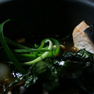 A close up: Fish and mushroom Japanese style stew in a hot clay pot / Pearl onions and mushrooms / Salmon and Corvina / Nori Seaweed / Aromatic rice