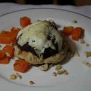 """[Vegetarian version] """"Liege"""" waffle topped with pear poached in red wine and melted three types of cheese, orange vegetables and roasted cashew."""
